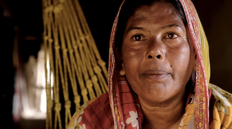 "Lufti, 71, is Ashida's mother-in-law. Her son, Ramzan, works as a tailor in Kolkata because they can no longer farm their land. Still image from the film, ""Losing Ground."""