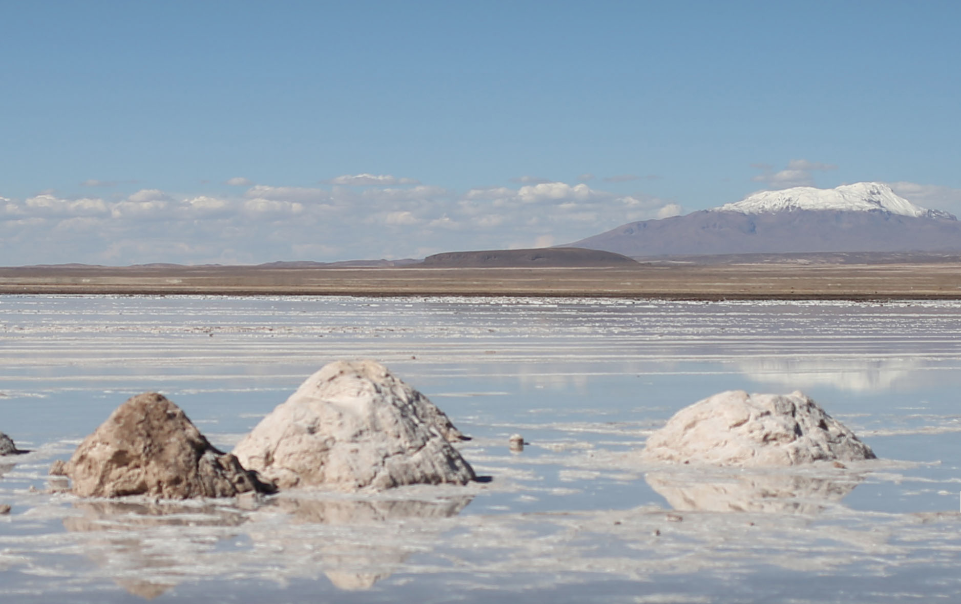 Bolivia's new constitution guarantees that the nation's natural resources belong to the Bolivian people. Citizens hope that lithium mining will boost the historically impoverished nation's economy.